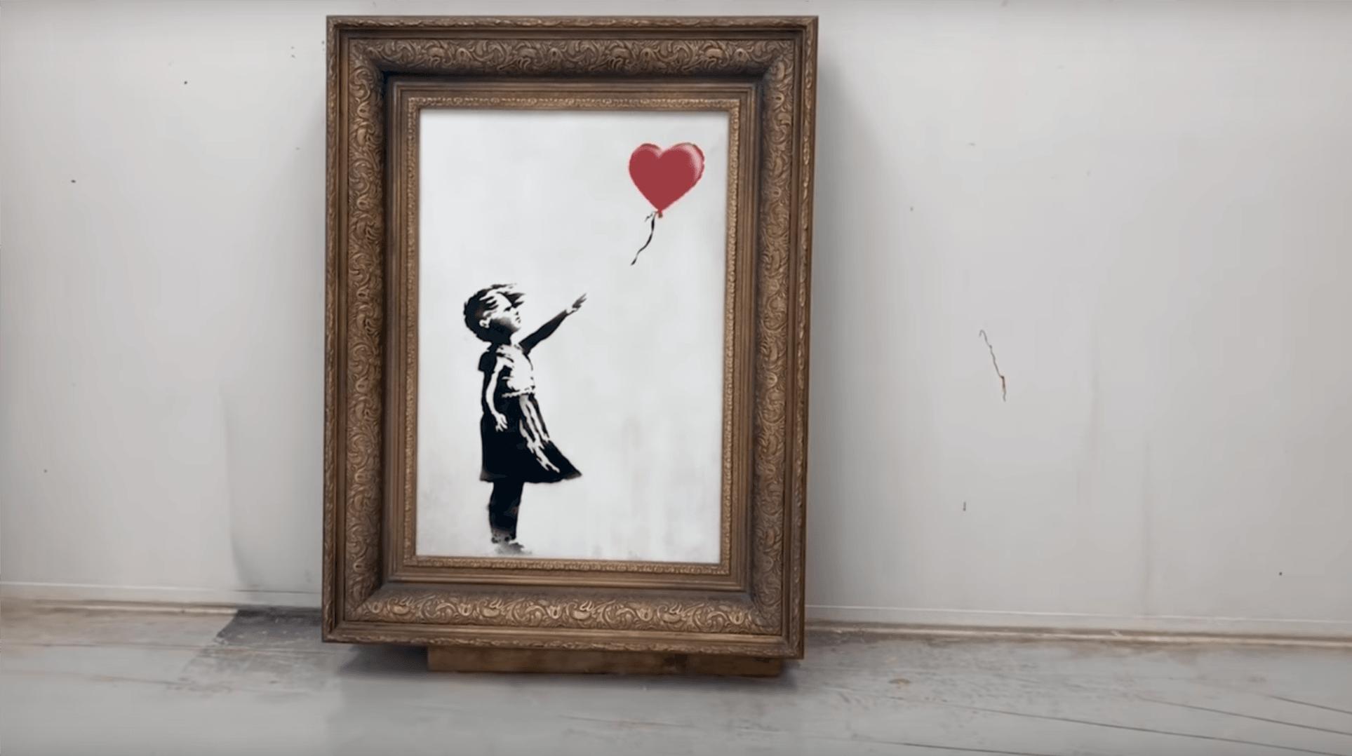 """Tabletowo.pl Banksy: płótno """"Dziewczynki z balonikiem"""" miało zostać zniszczone w całości, ale coś się zacięło Ciekawostki Kultura"""